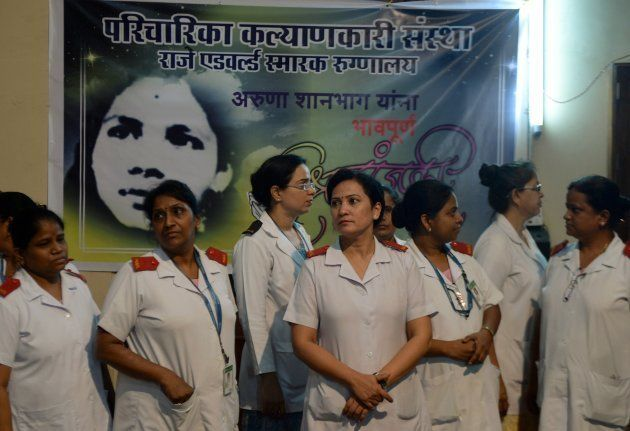 Indian nurses gather to pay their respect for nurse Aruna Shanbaug at a hospital in Mumbai on May 18,...