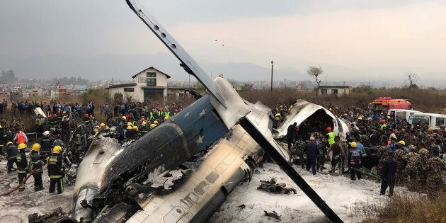 Wreckage of an airplane is pictured as rescue workers operate at Kathmandu airport, Nepal March 12, 2018....