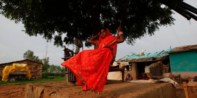 Child bride Krishna, 12, plays on an improvised swing outside her house in a village near Baran, located...