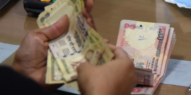 Unable To Exchange Old Notes, Woman Goes Topless In Front Of RBI