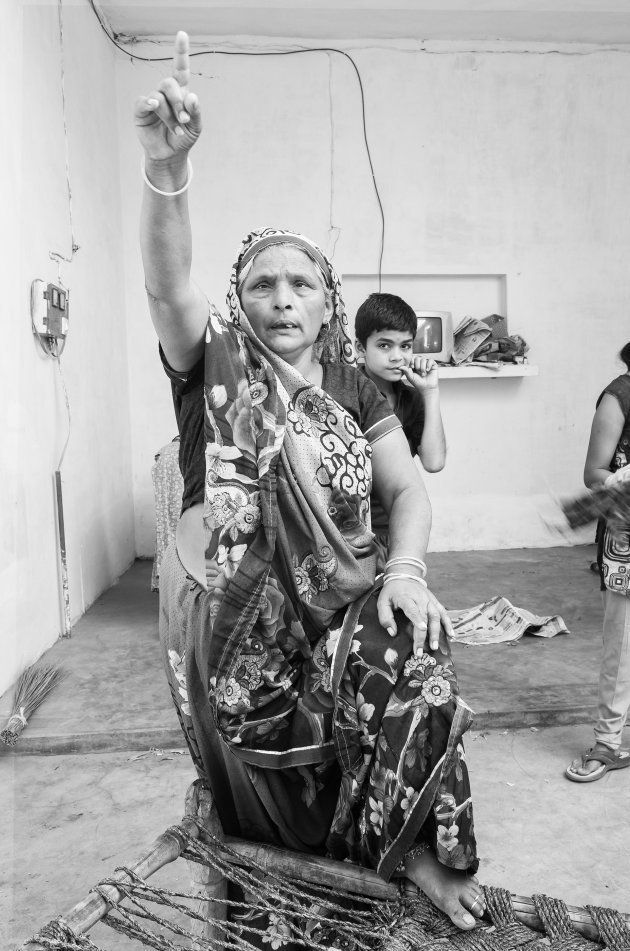 A Thakur woman in Nizampur gestures angrily while talking about how the Dalits were trying to 'break...
