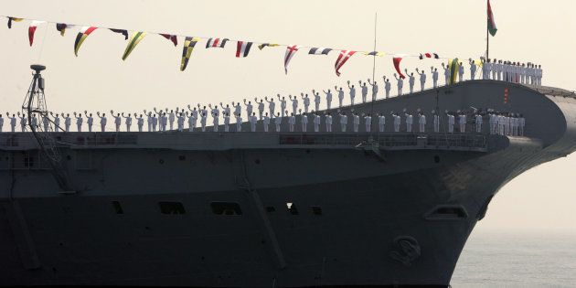 Indian Navy personnel stand on aircraft carrier Viraat, anchored at sea in Visakhapatnam, February 12,