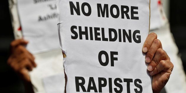 People hold placards at a protest against the rape of an eight-year-old girl, in Kathua, near Jammu and...