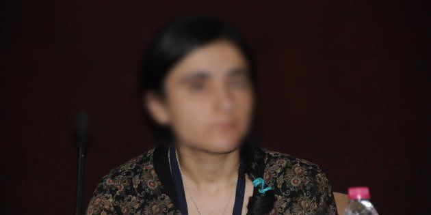Aji(surname redacted),a young Yazidi woman, who was sold as a sex slave after being captured by the...