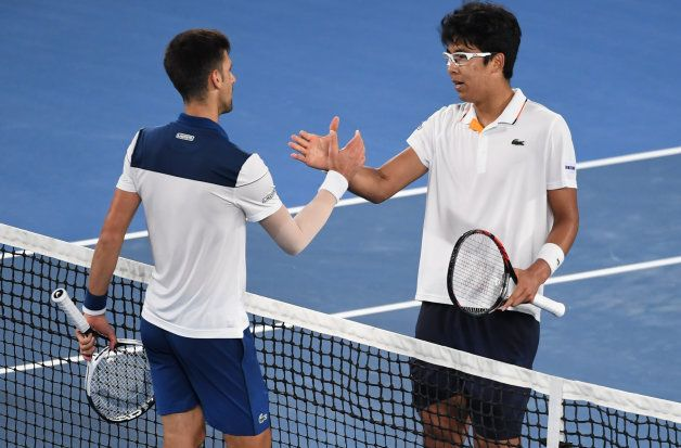 South Korea's Hyeon Chung and Serbia's Novak Djokovic shake hands after their men's singles fourth round...