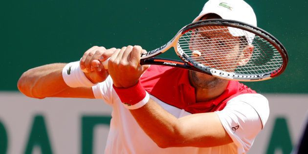 Serbia's Novak Djokovic in action during his third round match against Austria's Dominic Thiem on April...