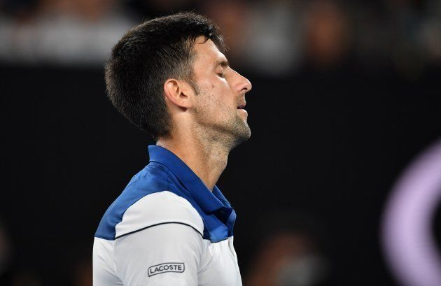Serbia's Novak Djokovic reacts after a point against South Korea's Hyeon Chung during the Australian...