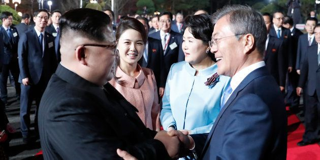 This picture taken on April 27, 2018 shows North Korea's leader Kim Jong Un (L) and South Korea's President...
