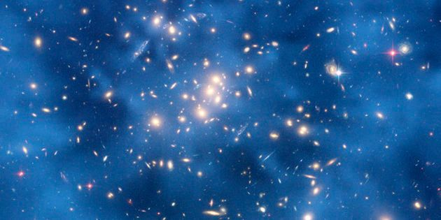 This undated image from the Hubble Space Telescope shows a ghostly ring of dark matter in a galaxy cluster...