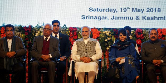 India's Prime Minister Narendra Modi (C), Jammu and Kashmir Chief Minister Mehbooba Mufti (2nd R) attend...