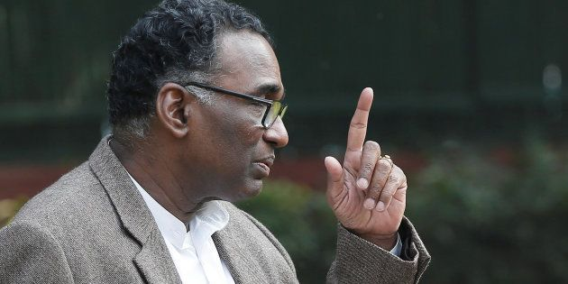 Justice Jasti Chelameswar gestures as he speaks during the news conference in New Delhi, India, January...