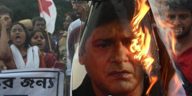 Indian leftist activists burn an effigy of actor and Trinamool Congress MP Tapas Pal in Kolkata on July...