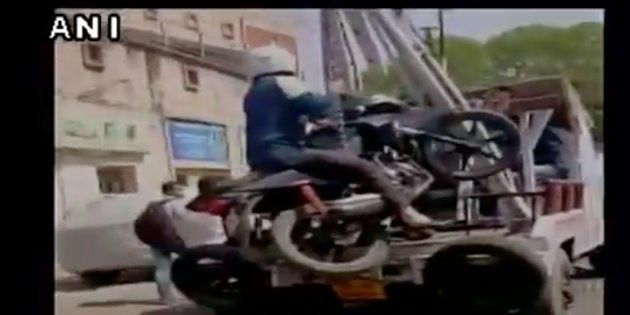 Kanpur Man Refuses To Dismount As Traffic Police Tows His Bike