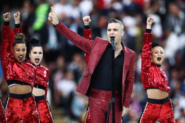 British singer Robbie Williams performs at the opening