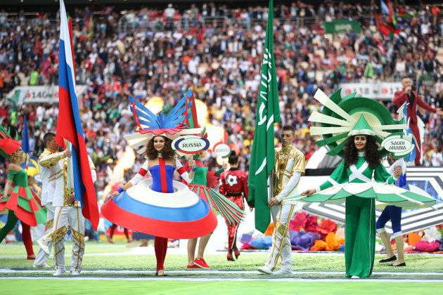 Artists representing the countries that were playing the first match -- Russia and Saudia Arabia -- perform...