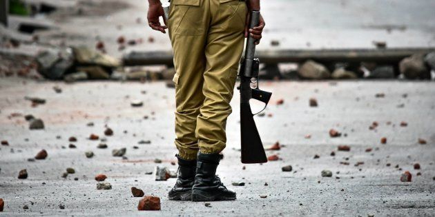 SRINAGAR, J&K, INDIA - 2018/05/08: An Indian policeman stands still during clashes in Srinagar, Indian...