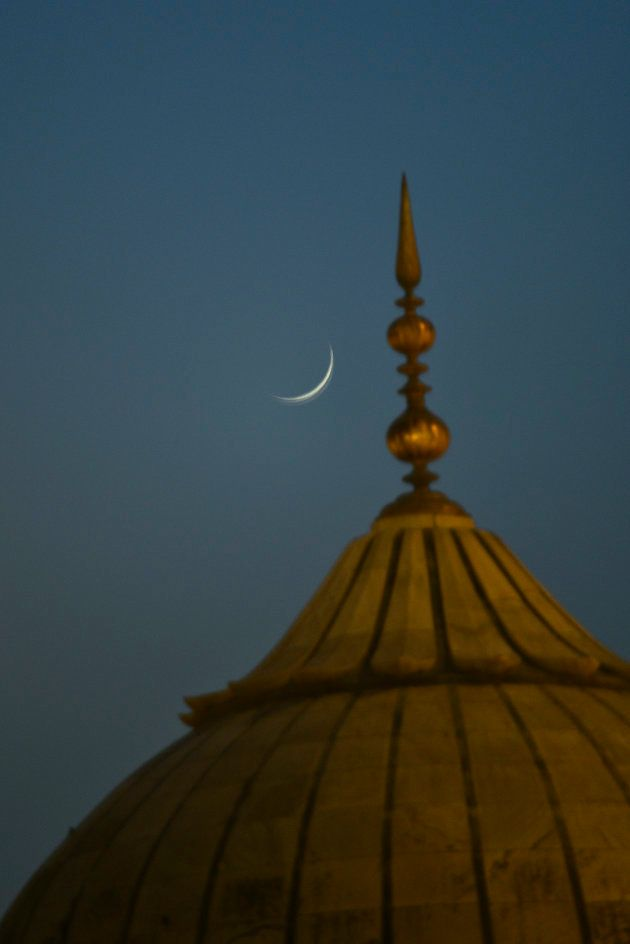 A view of crescent moon near a Jama Masjid Minaret on the eve of Eid