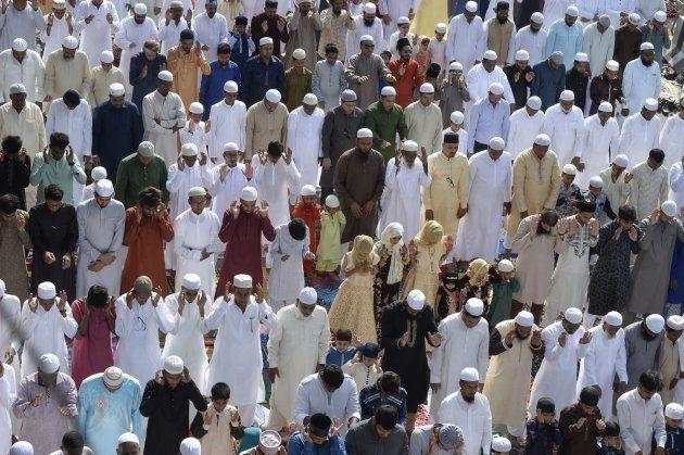 People offer Eid al-Fitr prayers outside Eidgah-Bilal, in