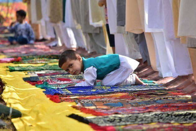 A boy looks on as prayers were offered in