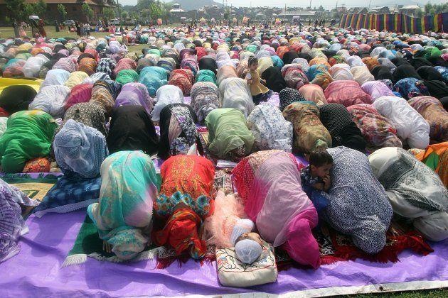 Women offer prayers in