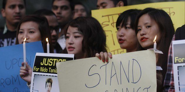 Students from North Eastern India during a candle light vigil against racism and the beating and killing...