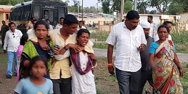 Relatives of those murdered in the Maharastra lynching incident being led away from the crime scene area...