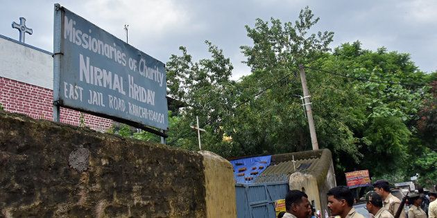 Police stand outside a home which provides shelter for pregnant unmarried women run by the Missionaries...