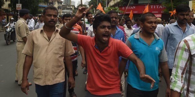 Indian members of the Maratha community in the state of Maharashtra shout slogans during a protest in...