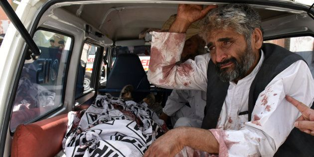 A man mourns the death of a relative, who was killed in a suicide blast in Quetta, Pakistan July 25,...