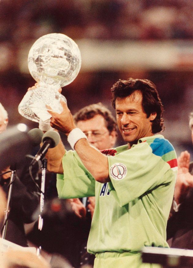 Imran Khan holds aloft the World Cup trophy after Pakistan's 22-run win against England in the Cricket...
