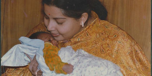 File Photo of AIADMK leader and Tamil Nadu Chief Minister J Jayalalithaa with an infant on May 19, 1995...