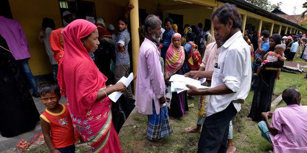 Villagers wait outside the National Register of Citizens (NRC) centre to get their documents verified...