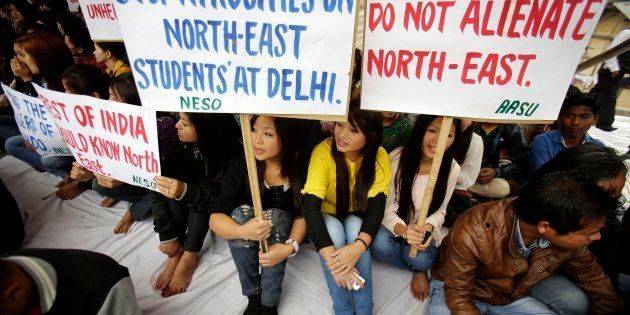 Members of North East Students Organization (NESO) hold placards as they participate in a protest in
