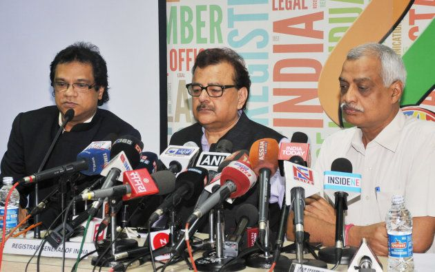 Registrar General of India Sailesh (C) and NRC state coordinator Prateek Hajela (L) addresses a press conference on the final draft of Assam's National Register of Citizens, at NRC office, Bhangagarh on July 30, 2018 in Guwahati, India.