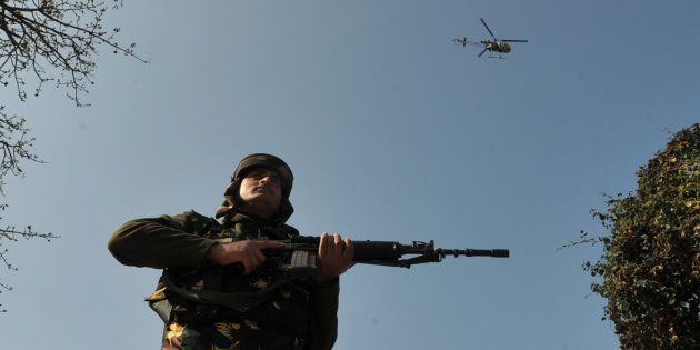 A army helicopter hovering over the sky during a search operation outside the camp of the General Engineering...