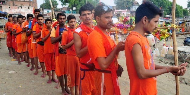 ALLAHABAD, UTTAR PRADESH, INDIA - 2017/07/14: Devotees of lord Shiva called Kanwariya doing rituals in...