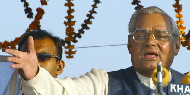 Indian Prime Minister Atal Behari Vajpayee gestures as he addresses a public rally in Faizabad, in the...
