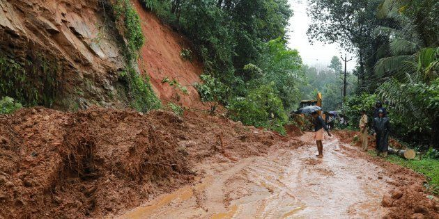 Indian rescuers conduct rescue operations after a landslide at Kuttampuzha village in Ernakulam district...