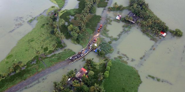 An aerial view shows partially submerged road at a flooded area in the southern state of Kerala, India,...