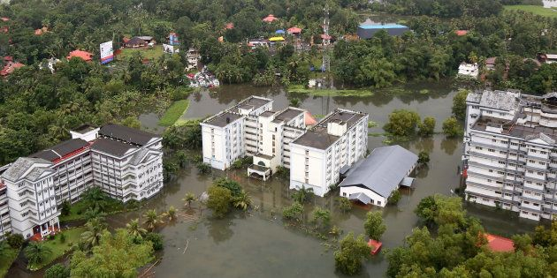 An aerial view shows partially submerged buildings at a flooded area in the southern state of Kerala,...