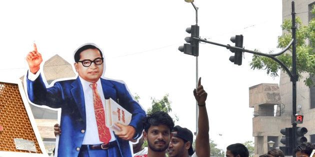 NEW DELHI, INDIA - MAY 20: A protestor carries a giant cut-out of Dr. BR Ambedkar during a protest by...