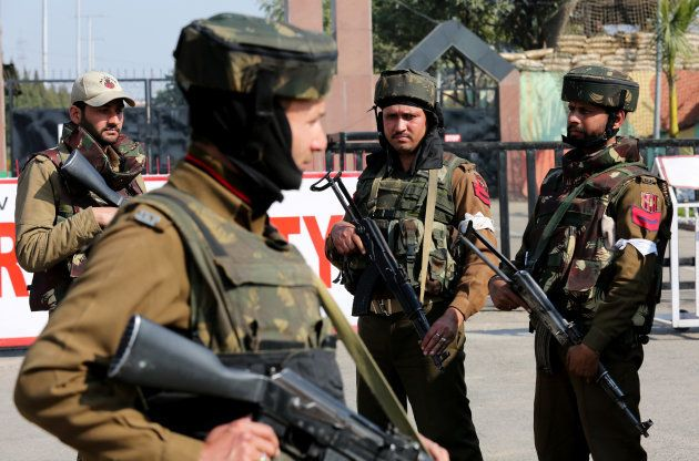 Indian army soldiers stand guard outside an army camp after suspected militants attacked the camp, in...