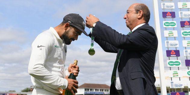 Captain Virat Kohli receives his man of the match award from Richard Tennant, chairman of Nottinghamshire...