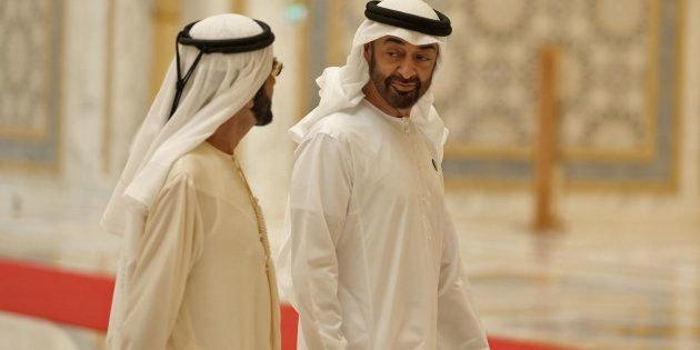 Abu Dhabi's Crown Prince Sheikh Mohammed bin Zayed Al Nahyan (R) walks with Dubai Ruler and Minister...