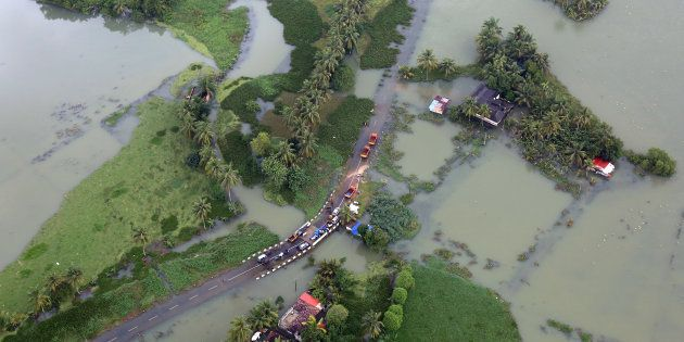 A partially submerged road at a flooded area in Kerala on 19