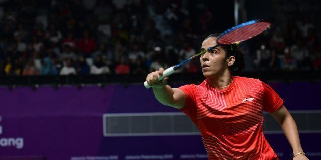 India's Saina Nehwal hits a return against Taiwan's Tai Tzuying in their women's singles semi-finals...
