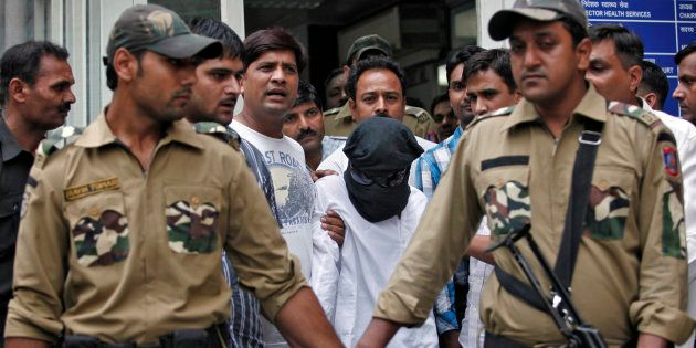 Sayeed Zabiuddin Ansari, also known as Abu Jundal, with his face covered, leaves from a hospital in New...