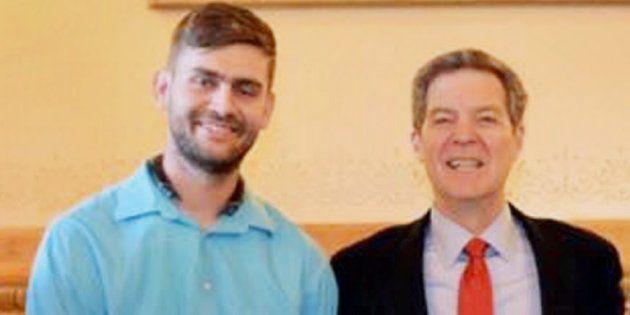 File photo of Kansas Governor Sam Brownback with Ian