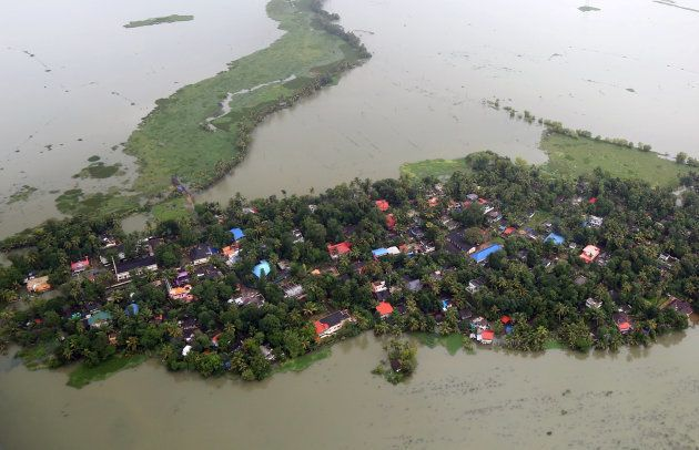 An aerial view of partially submerged houses at a flooded area in Kerala on 19
