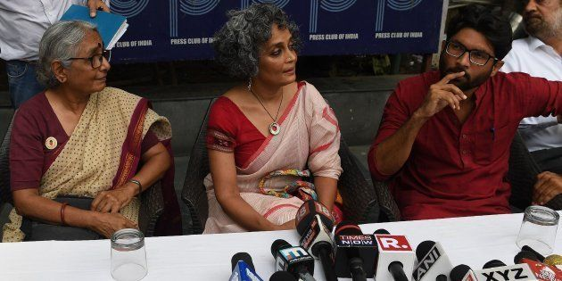 (From left) Aruna Roy, Arundhati Roy and Jignesh Mevani at the press conference in New Delhi on